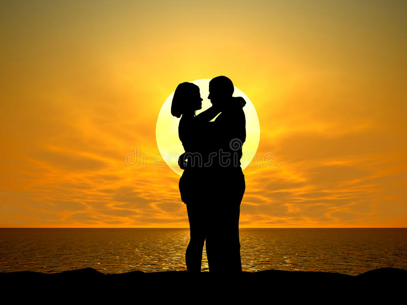 Silhouetted couple at sunset. Silhouetted couple embracing on beach with golden sunset background stock image