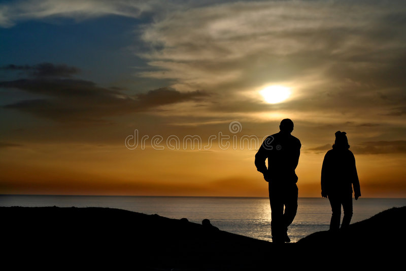 Download Silhouetted Couple At Sunset Stock Photo - Image: 1948988