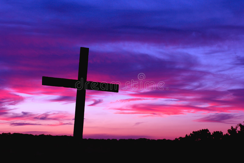 Silhouetted Cross and Sunset royalty free stock photo