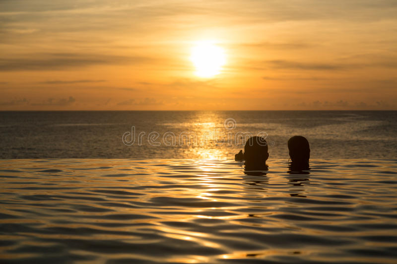 Download Silhouetted Heads Against Infinity Edge Pool Stock Image - Image of people, edge: 27658367