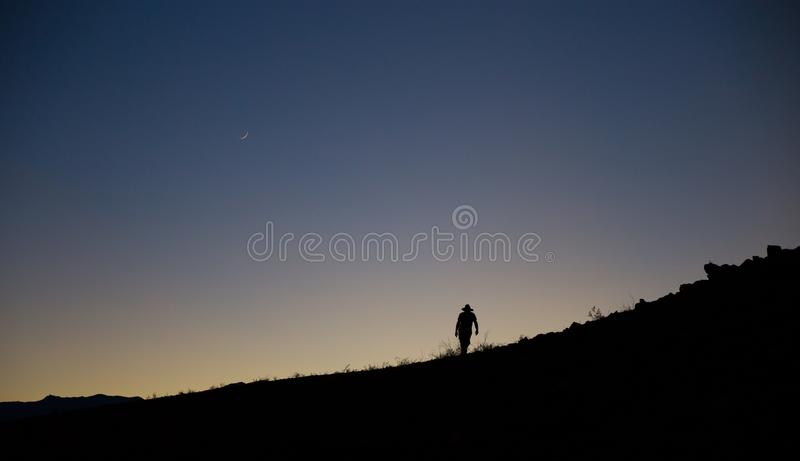 Silhouetted hike at disk stock photos