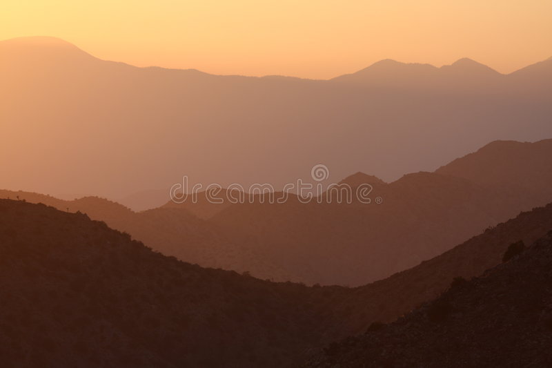 Download Silhouetted Mountain Sunset Stock Photo - Image: 6592524