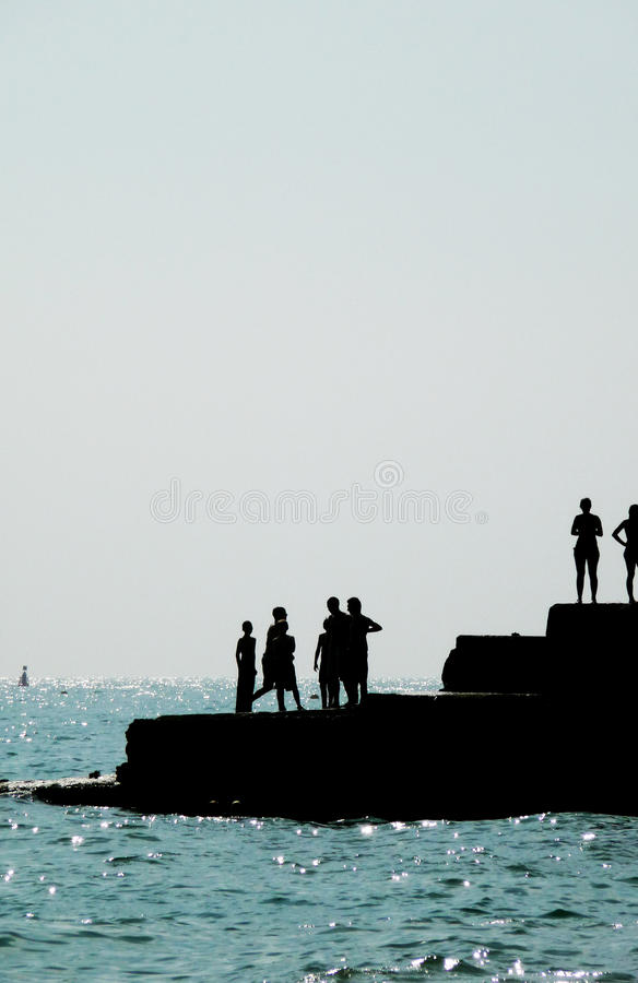 Download Silhouetted People On Brighton Coast Stock Photo - Image: 10195110