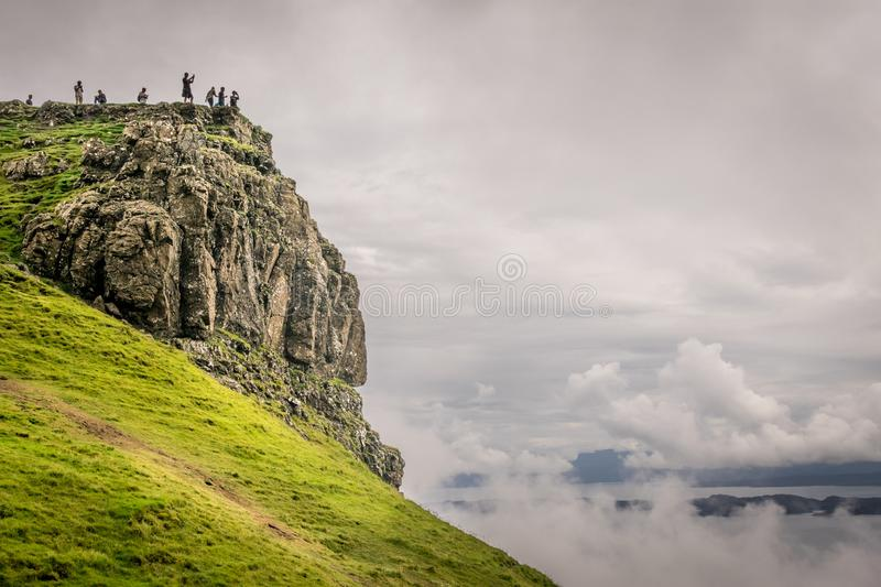 Silhouetted people on a mountain top enjoying the view stock photography