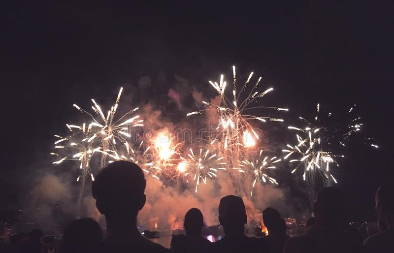 Silhouetted People Watching a Fireworks Display royalty free stock images