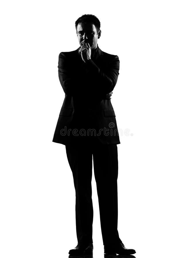 Silhouetteer de mens die peinzend denkt royalty-vrije stock afbeelding