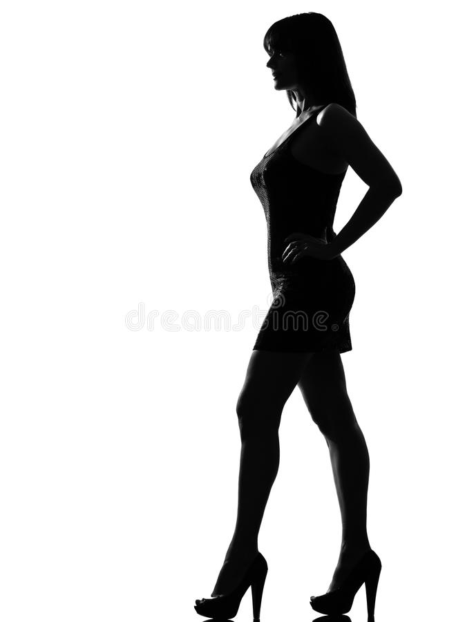 silhouetteer volledige lengte van het vrouwen de bevindende profiel stock foto
