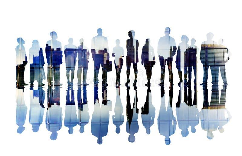 Silhouetten van Bedrijfsmensen Overlayed met Cityscape stock fotografie