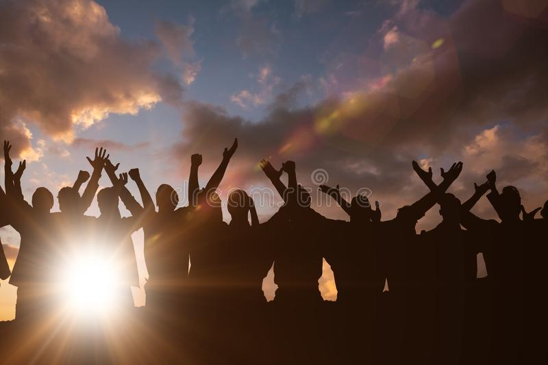 Composite image of silhouetters celebrating stock photography