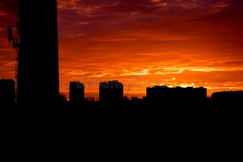 Silhouettes of buildings at sunset, cityscape. Sunset in the city royalty free stock photography