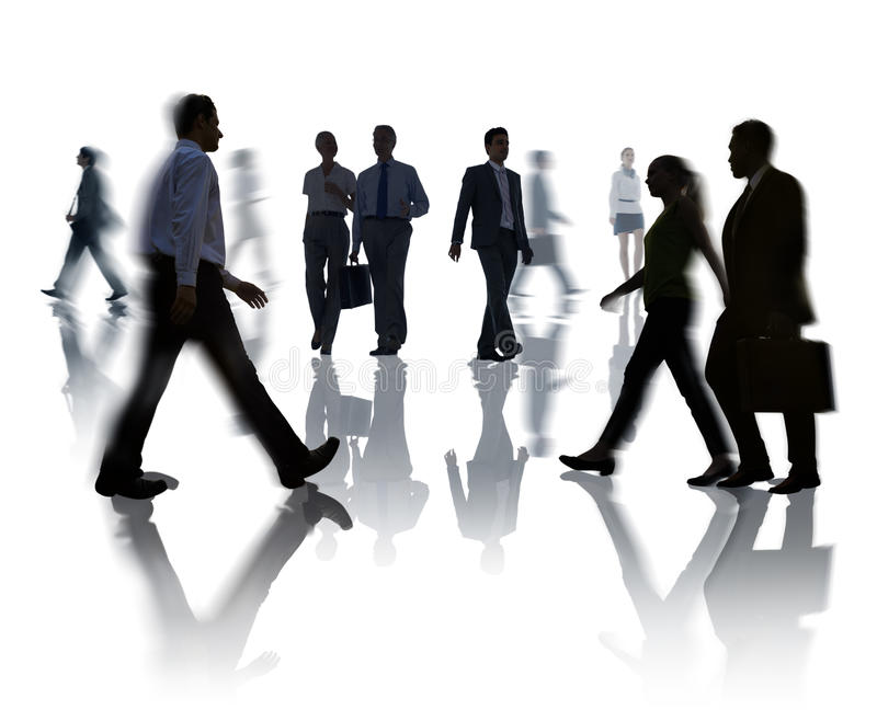 Silhouettes of Business and Casual People Walking.  stock photography