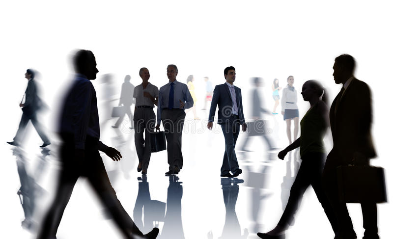 Silhouettes of Business and Casual People Walking.  royalty free stock image