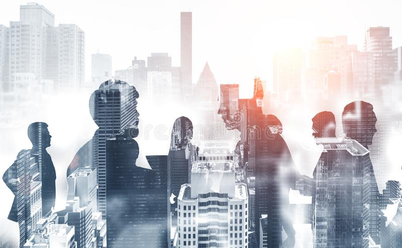 Silhouettes of business people in gray city royalty free stock image