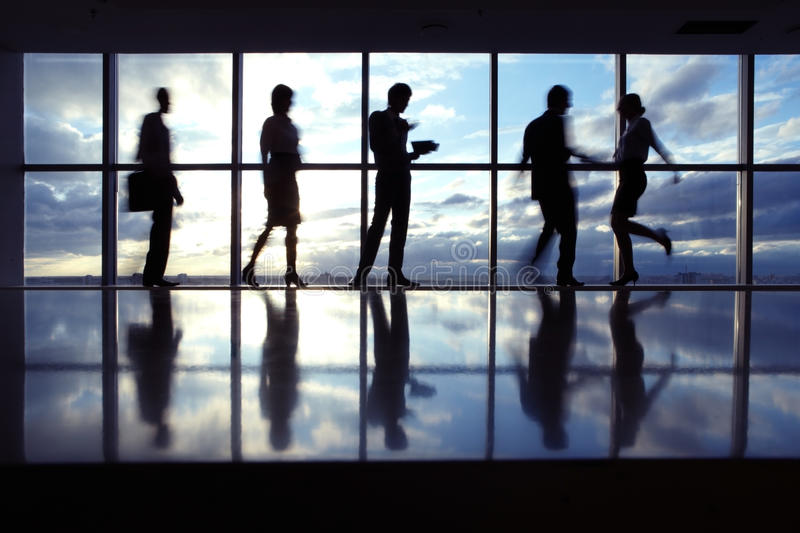 Silhouettes of business people stock photo