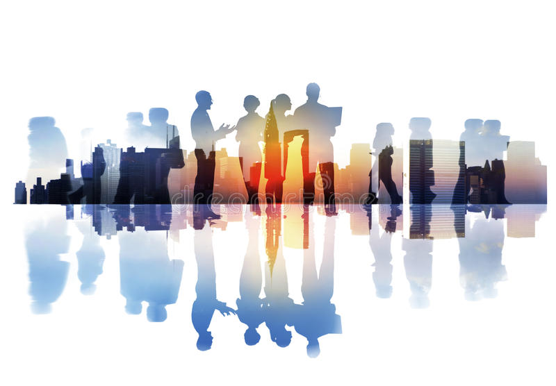 Silhouettes of Business People Overlaid with Cityscape.  stock photos