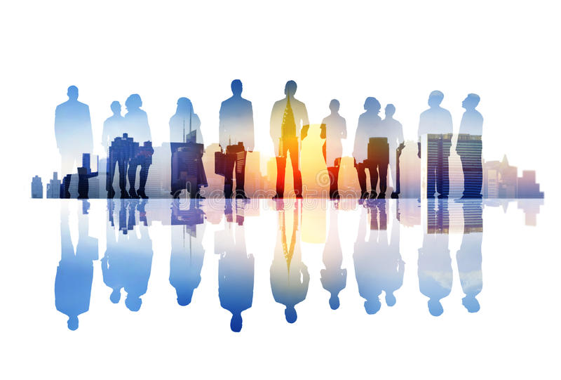 Silhouettes of Business People Overlaid with Cityscape.  royalty free stock photos