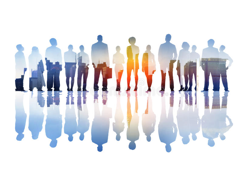 Silhouettes of Business People Overlaid with Cityscape.  royalty free stock photo