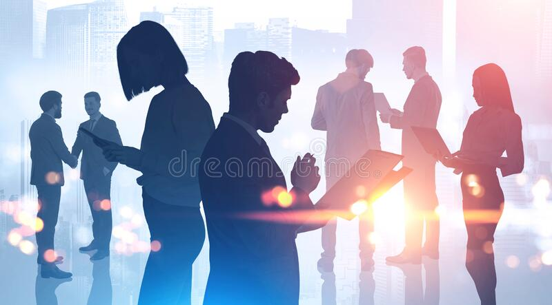 Silhouettes of business people. Partnership royalty free stock photo