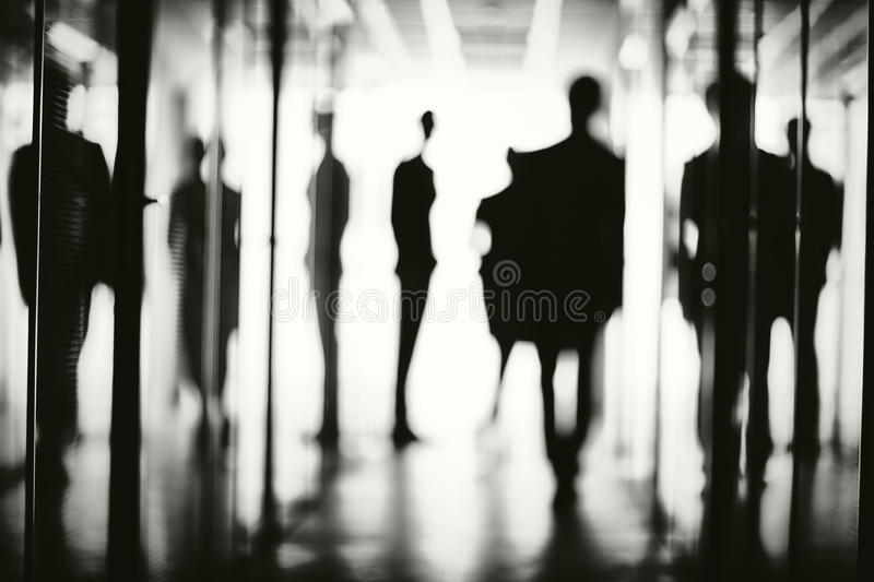 Silhouettes of business people royalty free stock photography