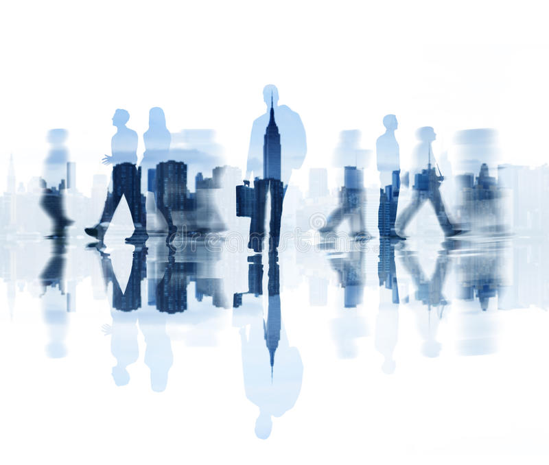 Silhouettes of Business People Walking and City Background royalty free stock image