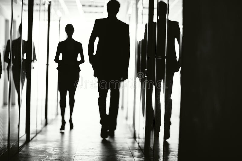 Silhouettes of business people stock photos
