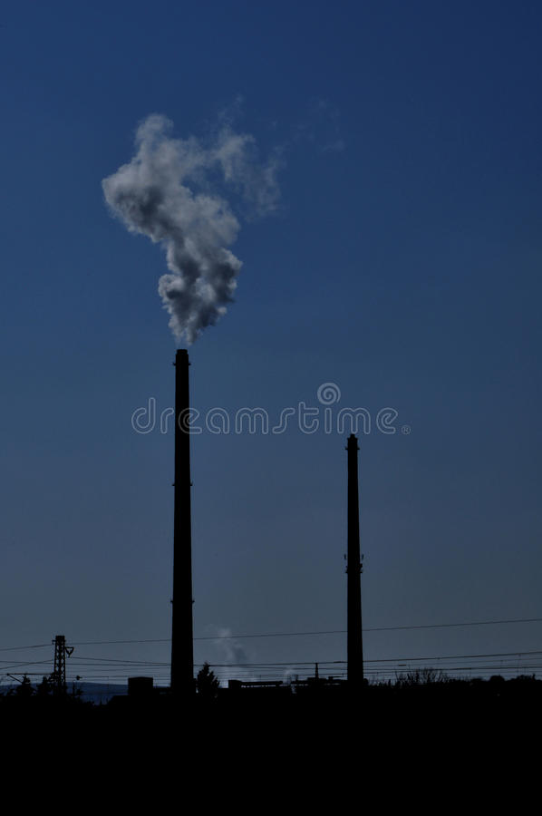 Download Silhouettes Of Chimneys With Fog Stock Photo - Image: 32216732