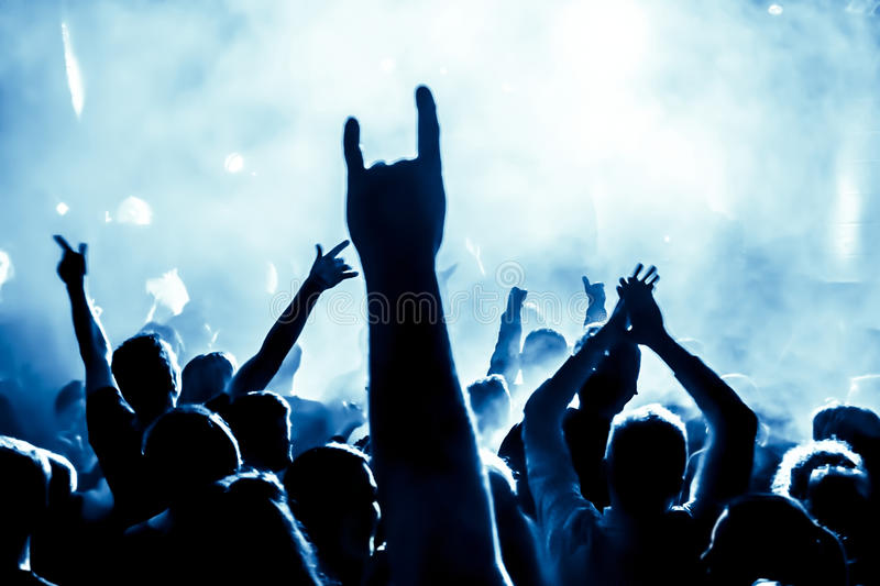 Silhouettes of concert crowd stock images