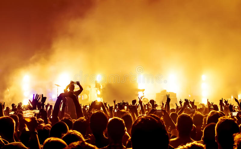 Silhouettes of concert crowd stock photo