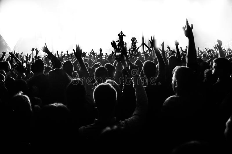 Download Silhouettes Of Concert Crowd In Front Of Bright Stage Lights With Confetti Stock Image - Image of crowd, entertainment: 83284187