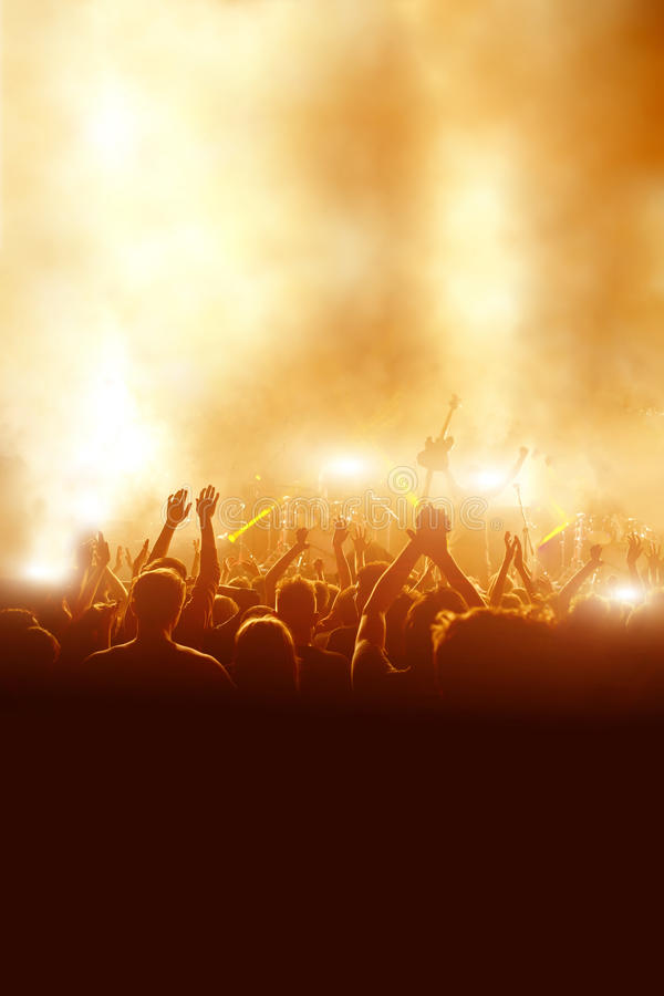 Silhouettes of concert crowd in front of bright stage lights. stock images