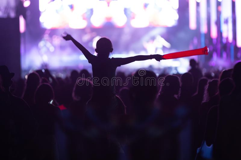 Silhouettes of concert crowd in front of stage lights. Fans during a life concert stock photos