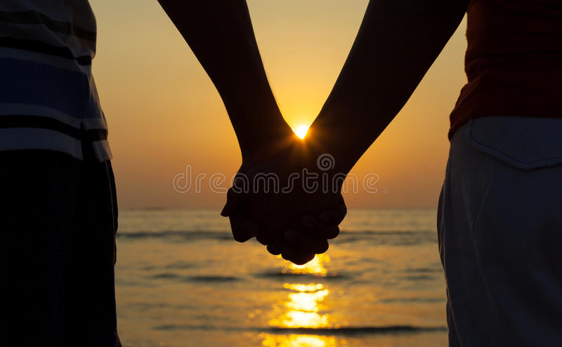 Silhouettes couples holding hands. royalty free stock images