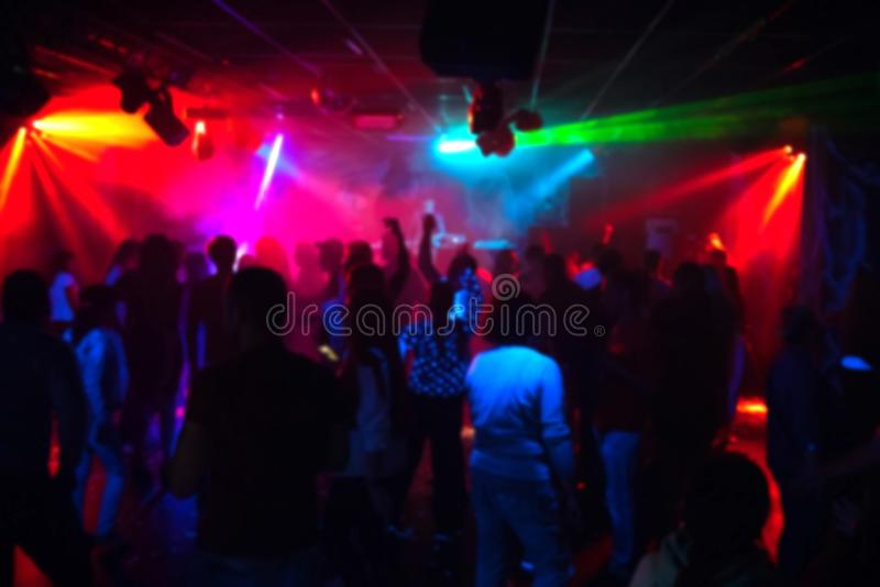 Silhouettes of a crowd of people dancing in a nightclub on the dance floor at a party royalty free stock photo