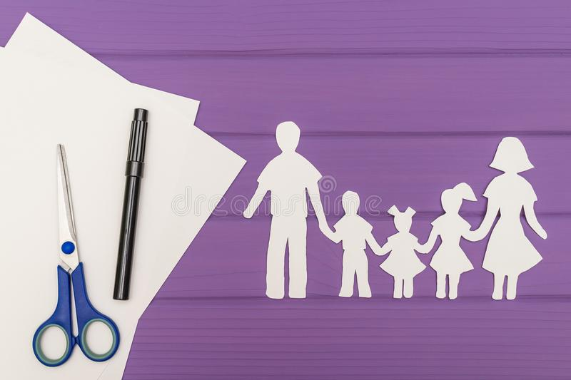 The silhouettes cut out of paper of man and woman with two girls and boy royalty free stock photography
