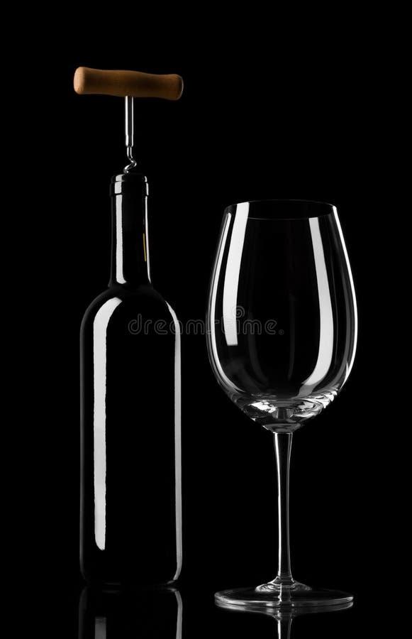Silhouettes d'une bouteille et d'un verre de vin photo stock
