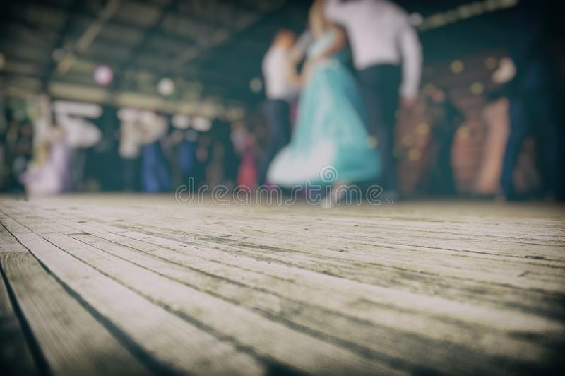 Silhouettes of Dancing Couples on the Stage. Blurred Background. Silhouettes of Dancing Couples on the Stage. A Group of People Participates in the Dance stock photography