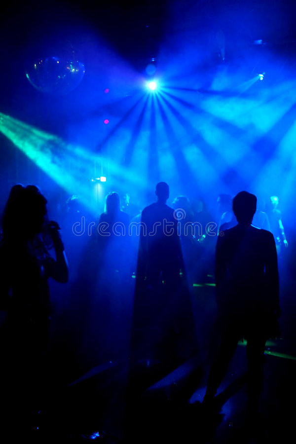 Silhouettes of dancing teenagers. Dancing people in an underground club royalty free stock image