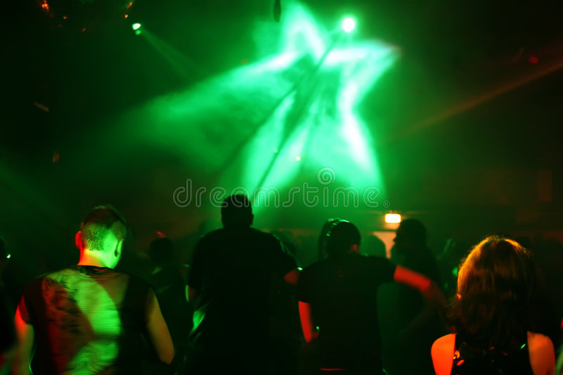 Silhouettes of dancing teenagers stock image