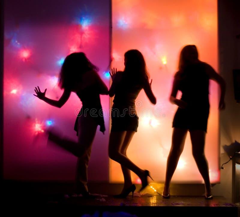 Silhouettes de filles de danse photo stock