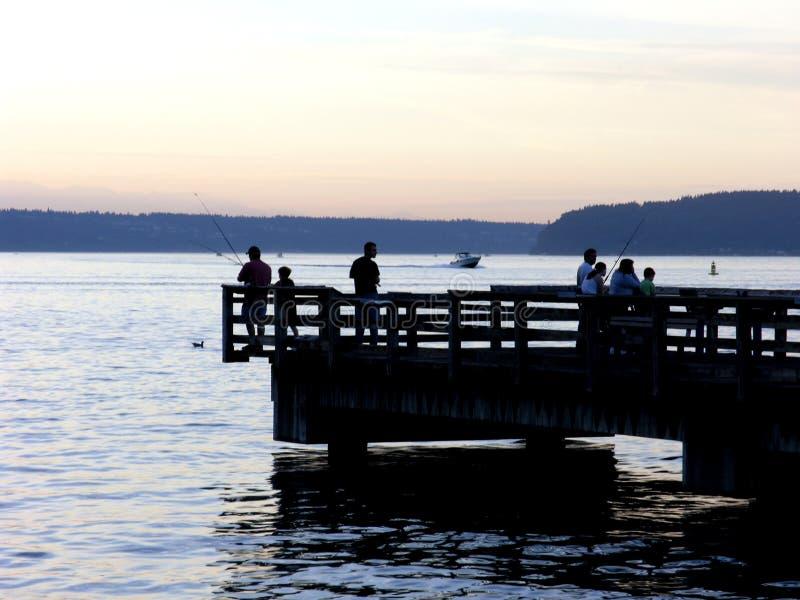 Silhouettes de pêche photographie stock libre de droits