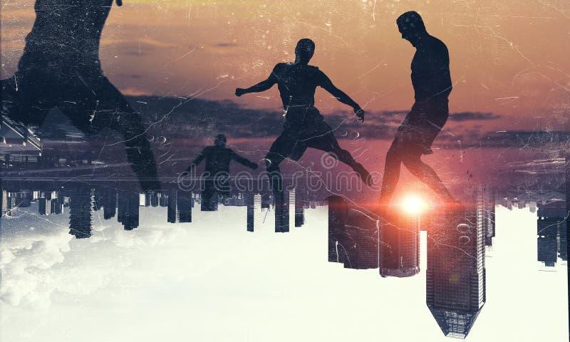 Silhouettes des footballeurs Media mélangé image stock
