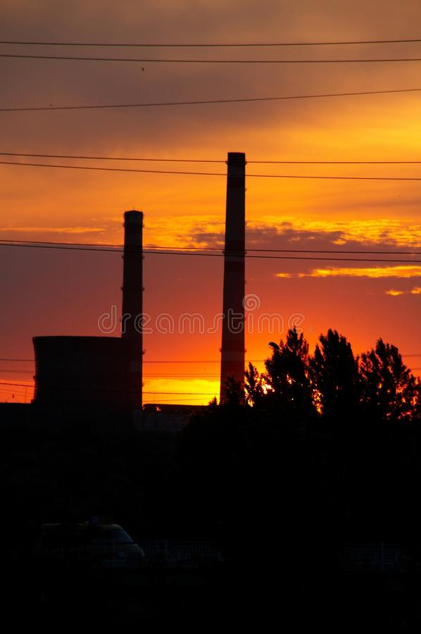 Silhouettes of factory pipes royalty free stock photo