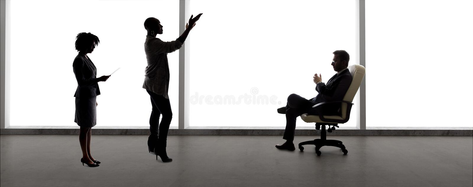 Silhouettes of Female Actors in an Audition with a Casting Director stock photos