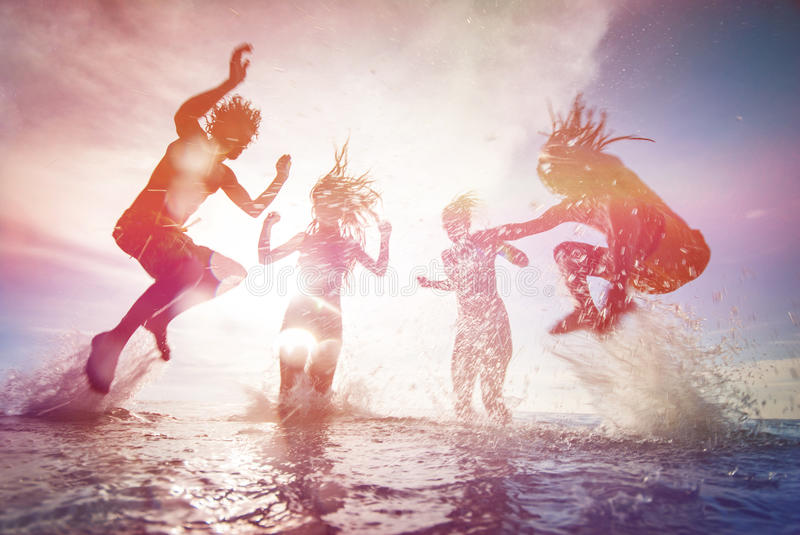 Silhouettes of happy young people stock photography