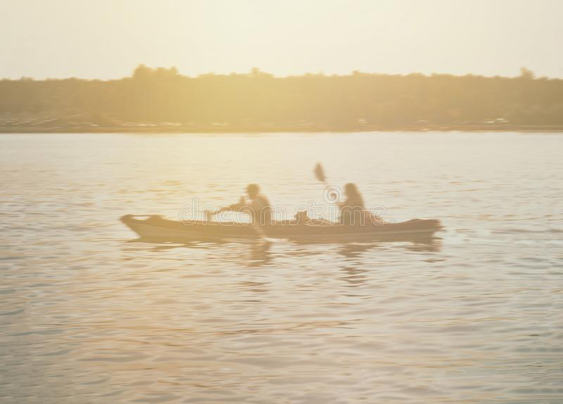 Kayakers at dusk. Silhouettes of kayakers at dusk stock photography