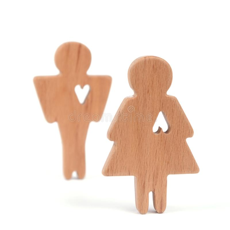 Silhouettes of man, woman and heart cut out inside the shapes on a white background. Happy couple in love. Male and female, differ. Silhouettes of man, woman and stock photos