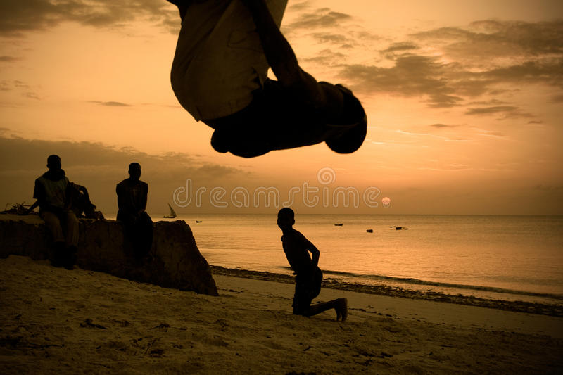 Silhouettes Of Men Working Out On The Beach Stock Image ...