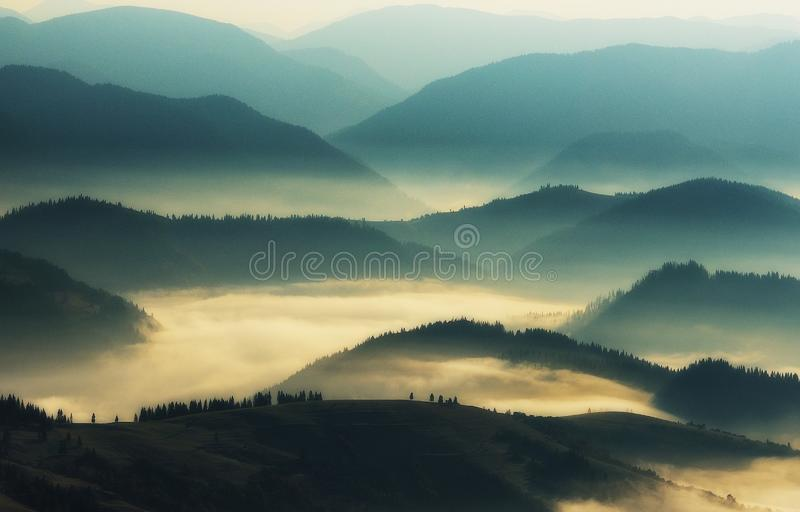 Silhouettes of mountains. A misty autumn morning. Dawn in the Carpathians. Foggy rivers royalty free stock photo