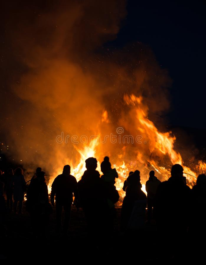 Free Silhouettes Of People In Frontof Big Fire Stock Photo - 111828770