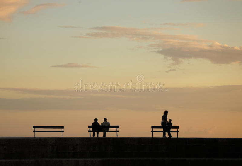 Download Silhouettes over sunset stock photo. Image of light, family - 16538120